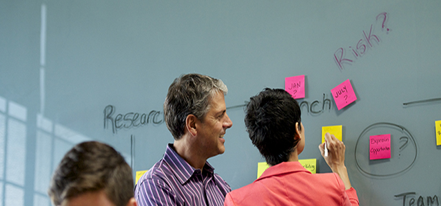 People reviewing plans during a meeting